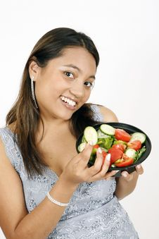 Free Girl Eating Salad Royalty Free Stock Images - 9303199