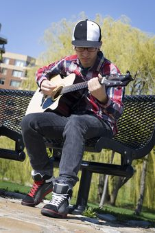 Free Young Man Playing Guitar In Park Stock Photography - 9303712