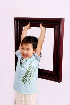 Free Boy And Frame Royalty Free Stock Photo - 9304165