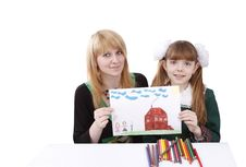 Mother And Daughter Are Holding The Picture. Stock Image