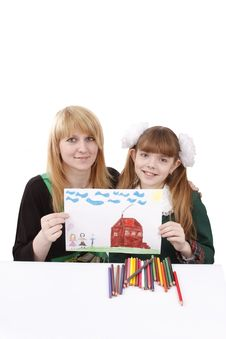 Mother And  Daughter Are Holding The Picture. Royalty Free Stock Photography