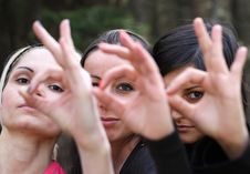 Free Girls Looking Through Their Crossed  Fingers Stock Image - 9304761