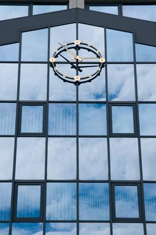 Free A Clock Against A Glass Wall Stock Image - 9306261