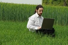 Free Man Sitting On The Grass, Working Stock Photo - 9306440