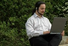 Free Man With Headset On A Tree Stock Photography - 9306542