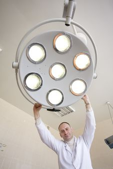 Surgeon With Surgical Lamp Stock Images