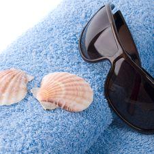 Towel, Shells, Sunglasses Royalty Free Stock Image