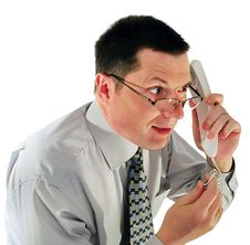 Free Man In Glasses With A Telephone Royalty Free Stock Photography - 9312157