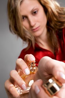Free Beautiful Caucasian Woman Spraying Perfume Royalty Free Stock Photos - 9312678