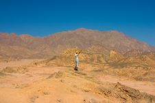 Man On The Top Of Hill In Desert Royalty Free Stock Image