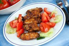 Grilled Chicken Legs With Salad Royalty Free Stock Photos