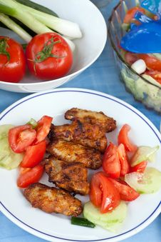 Grilled Chicken Legs With Salad Stock Photo