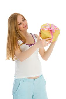 Pregnant Woman Holding A Gift In His Hands Stock Photo