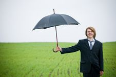 Smiling Businessman Holding Umbrella Stock Photos