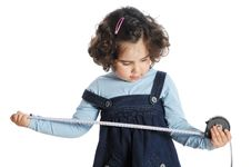 Free Little Girl Holding Tools Royalty Free Stock Image - 9319506