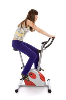 Free Teenager Doing Fitness On A Stationary Bike Stock Image - 9320301