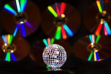 Free Disco Ball Over Music CDS With Rainbow Reflections Royalty Free Stock Image - 9320856