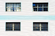 Free Windows On Blue White Facade Royalty Free Stock Image - 9322486