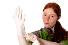 Natural Redhead Putting On Her Gloves For Work Royalty Free Stock Images