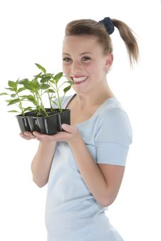 Free Girl Holding Young Plants Royalty Free Stock Images - 9330789