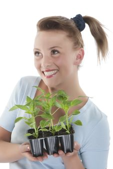 Free Girl Holding Young Plants Stock Image - 9330801