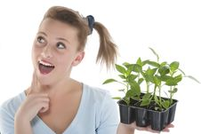 Free Girl Holding Young Plants Royalty Free Stock Photos - 9330858