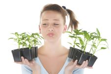 Free Smiling Girl Holding Young Plants Stock Photo - 9330900