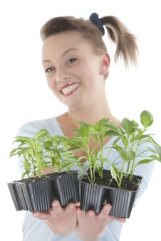 Free Smiling Girl Holding Young Plants Stock Photos - 9330913