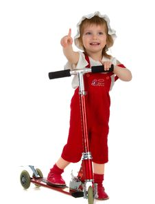 Little Girl And Her Scooter Stock Image