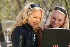 Women With Laptop In Park Royalty Free Stock Images