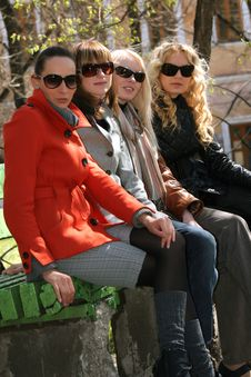 Four Women Relaxing On The Bench Royalty Free Stock Photo