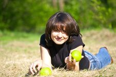 Fine Girl With An Apple In Its Left Hand Royalty Free Stock Photography