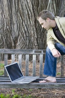 Man Looking At Laptop Computer Stock Photography