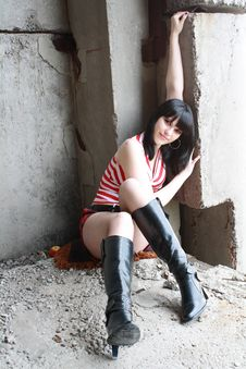 Beautiful Girl Sits On Construction Site Stock Image