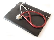 Free Stethoscope On Black Compendium Stock Images - 9339964