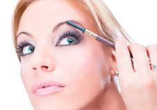 Free Nice Caucasian Model Applying Makeup With Brush Stock Image - 9349281