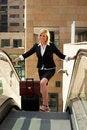 Free Businesswoman On Escalator Royalty Free Stock Photography - 9358457