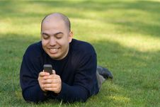 Free Young Man Messaging On The Mobile Phone Royalty Free Stock Images - 9350779