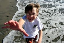Free Reaching Boy At Beach Royalty Free Stock Photography - 9351637