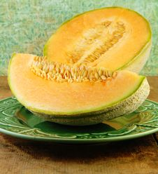 Sliced Cantaloupe On A Wooden Table Stock Images