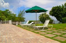Free Lawn-chairs By Poolside Royalty Free Stock Photo - 9353065