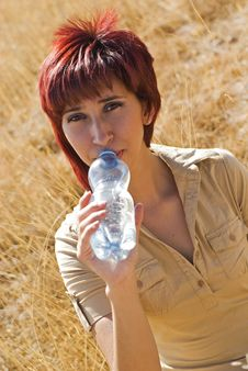 Free Woman Drinking Water Royalty Free Stock Photography - 9354937