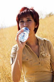 Free Latina Woman Drinking Water Stock Image - 9355221