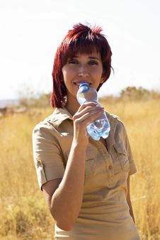 Woman Drinks Water Stock Images
