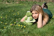 Free Funny Girl With A Toy Frog Stock Image - 9358081