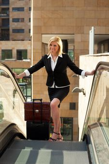 Free Businesswoman On Escalator Royalty Free Stock Photography - 9358457