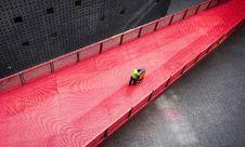 Free Man In Green Shirt Pushing Cart On Red Hallway Stock Photo - 93554900