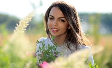 Free Woman In White Crew Neck Shirt Smiling And Surround With Flowers And Plants During Daytime Stock Image - 93555011