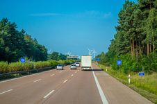 Free Vehicle Driving On Freeway Towards Wind Turbines Stock Photo - 93555610