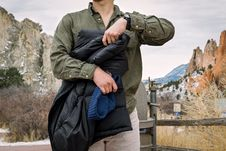 Free Man In Green Jacket Holding Another Down Black Jacket Royalty Free Stock Photography - 93556087